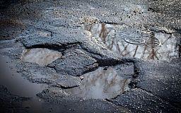 Дорога по улице Рзянкина. 10 лет гарантии и ямы спустя 4 месяца