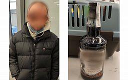 Криворожанин собирался перепродать бутылку краденого алкоголя